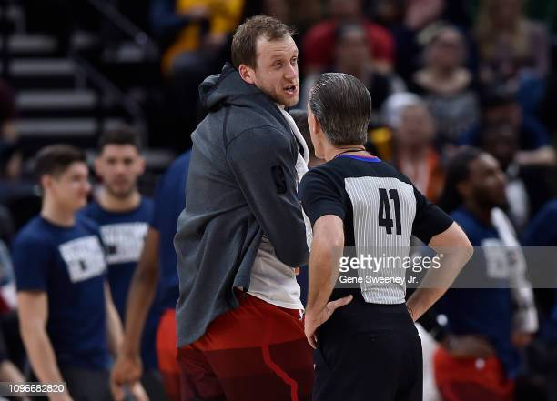 Joe Ingles of the Utah Jazz complains to referee Ken Mauer during a time out in the second half of a NBA game against the San Antonio Spurs at Vivint...