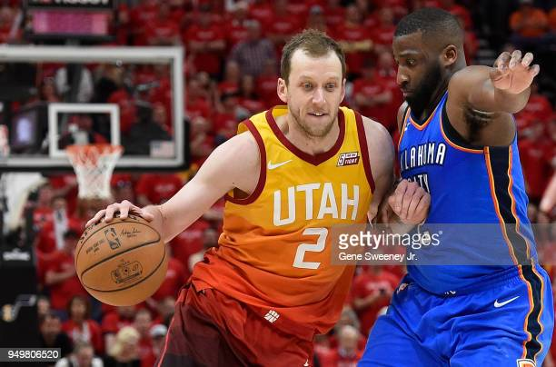 Joe Ingles of the Utah Jazz drives against Raymond Felton of the Oklahoma City Thunder in the second half during Game Three of Round One of the 2018...