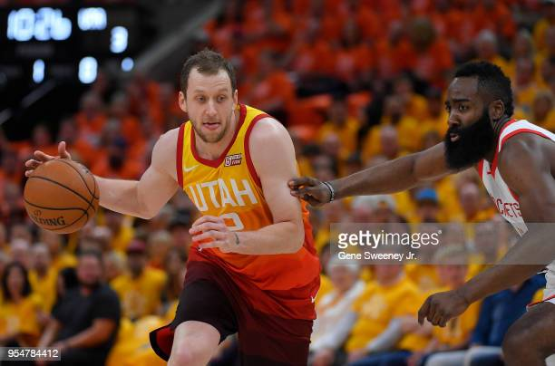 Joe Ingles of the Utah Jazz drives around the defense of James Harden of the Houston Rockets in the first half during Game Three of Round Two of the...