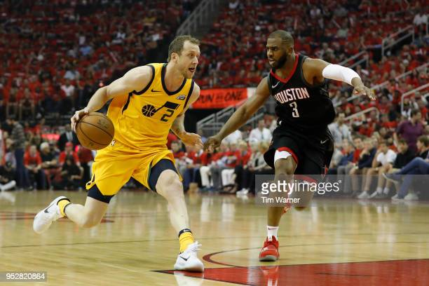 Joe Ingles of the Utah Jazz drives to the basket defended by Chris Paul of the Houston Rockets in the first half during Game One of the Western...