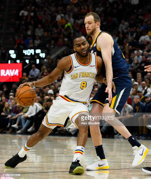 Joe Ingles of the Utah Jazz guards Alec Burks of the Golden State Warriors during a game at Vivint Smart Home Arena on December 13, 2019 in Salt Lake...
