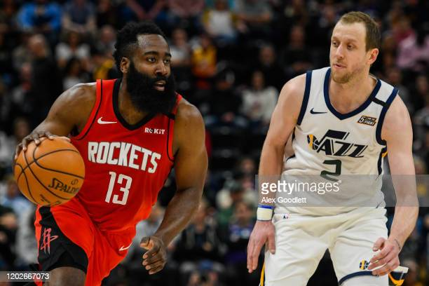 Joe Ingles of the Utah Jazz guards James Harden of the Houston Rockets during a game at Vivint Smart Home Arena on February 22, 2020 in Salt Lake...