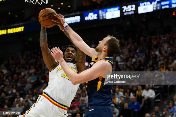 Joe Ingles of the Utah Jazz guards Marquese Chriss of the Golden State Warriors during a game at Vivint Smart Home Arena on December 13, 2019 in Salt...