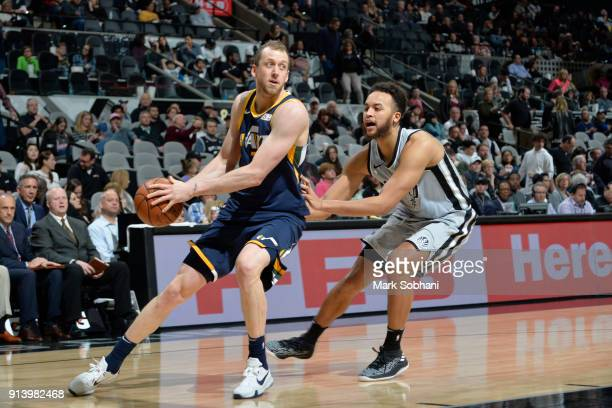 Joe Ingles of the Utah Jazz handles the ball against Kyle Anderson of the San Antonio Spurs on February 3 2018 at the ATT Center in San Antonio Texas...