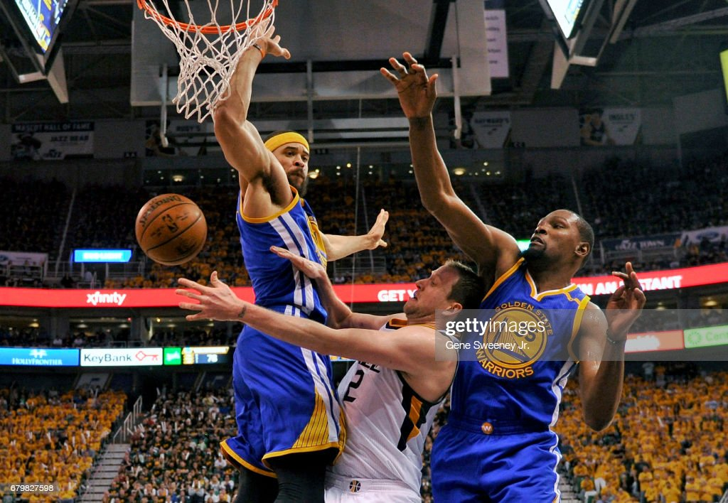 Joe Ingles #2 of the Utah Jazz passes around the defense of JaVale McGee #1 and Kevin Durant #35 of the Golden State Warriors in the second half of the Jazz 102-91 loss in Game Three of the Western Conference Semifinals during the 2017 NBA Playoffs at Vivint Smart Home Arena on May 6, 2017 in Salt Lake City, Utah.