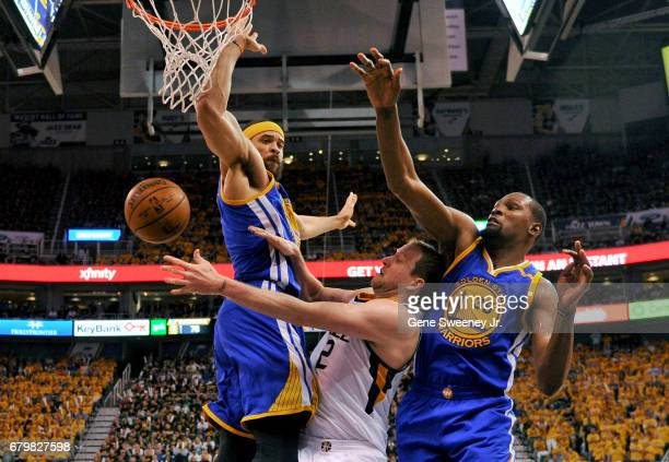 Joe Ingles of the Utah Jazz passes around the defense of JaVale McGee and Kevin Durant of the Golden State Warriors in the second half of the Jazz...