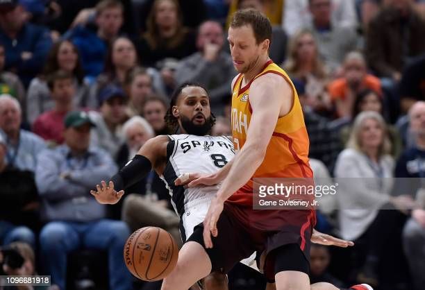Joe Ingles of the Utah Jazz pushes away defender Patty Mills of the San Antonio Spurs in the second half of a NBA game at Vivint Smart Home Arena on...