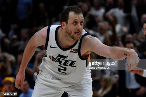 Joe Ingles of the Utah Jazz reacts to his three point basket in the second half of a NBA game against the Golden State Warriors at Vivint Smart Home...