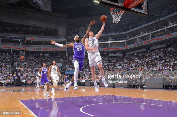 Joe Ingles of the Utah Jazz shoots a layup against Willie CauleyStein of the Sacramento Kings on October 17 2018 at Golden 1 Center in Sacramento...