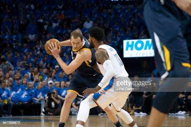 Joe Ingles of the Utah Jazz tries to keep ball away from Paul George of the Oklahoma City Thunder during the first half of Game One of the Western...