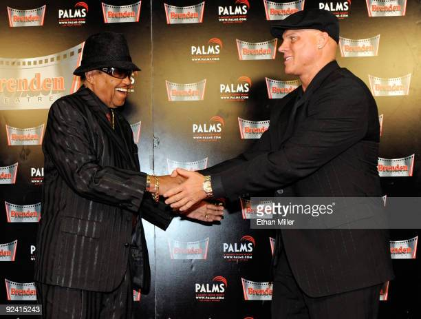 Joe Jackson and President and CEO of the Brenden Theatre Corp Johnny Brenden appear during the unveiling of a celebrity star honoring Jackson and the...