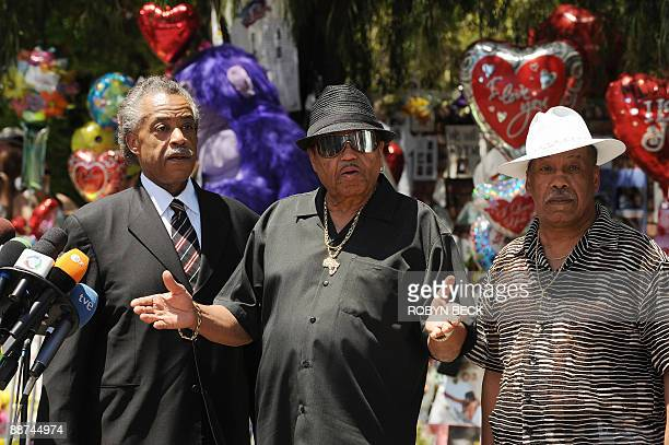 Joe Jackson father of Michael Jackson is flanked by the Rev Al Sharpton and Marshall Thompson an acquaintence of Joe Jackson during a news conference...