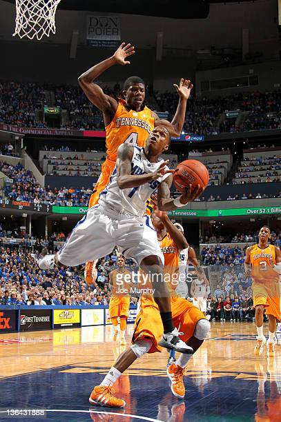 Joe Jackson of the Memphis Tigers shoots a layup against Wes Washpun of the Tennessee Vols on January 4 2012 at FedExForum in Memphis Tennessee...