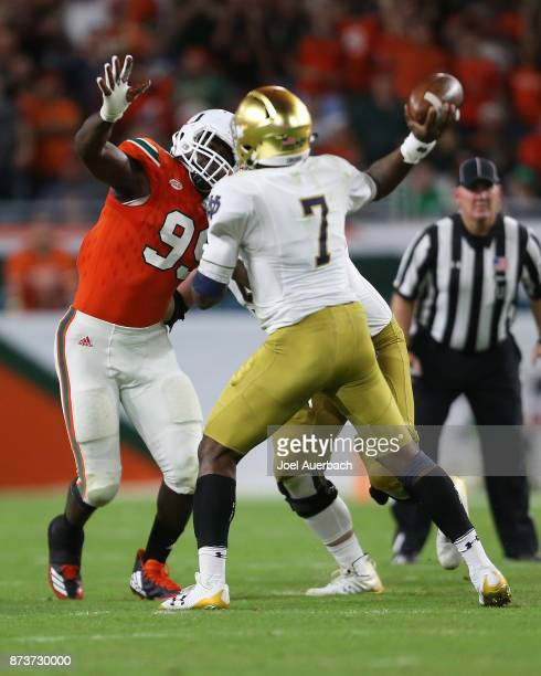 Joe Jackson of the Miami Hurricanes defends against Brandon Wimbush of the Notre Dame Fighting Irish on November 11 2017 at Hard Rock Stadium in...