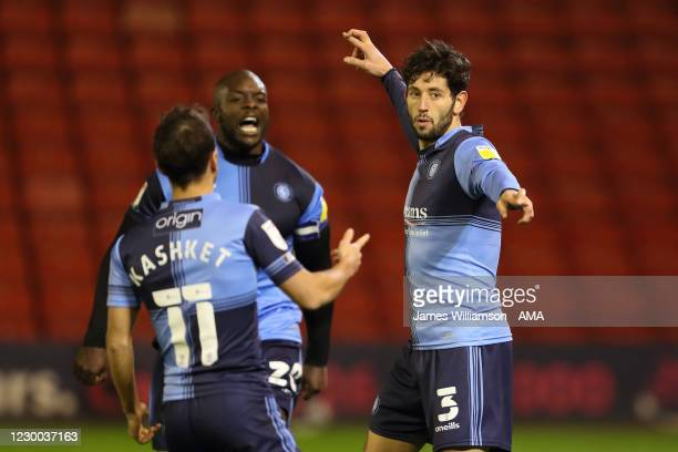 Joe Jacobson of Wycombe Wanderers celebrates after scoring a goal from the penalty spot to make it 1-1 during the Sky Bet Championship match between...