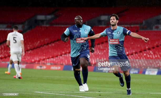 Joe Jacobson of Wycombe Wanderers celebrates with Adebayo Akinfenwa of Wycombe Wanderers after he scores from the penalty spot during the Sky Bet...