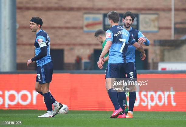 Joe Jacobson of Wycombe Wanderers celebrates with teammate David Wheeler after scoring his team's second goal during the FA Cup Third Round match...