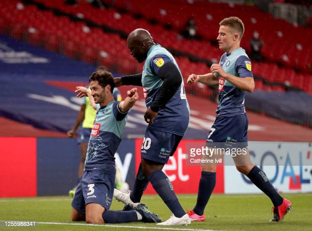 Joe Jacobson of Wycombe Wanderers is congratulated after he scores from the penalty spot during the Sky Bet League One Play Off Final between Oxford...