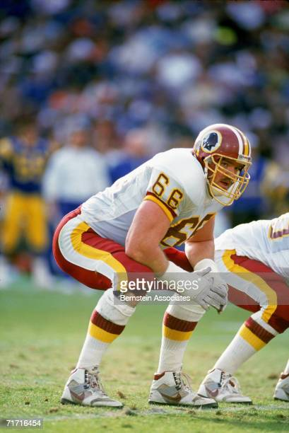 Joe Jacoby of the Washington Redskins gets ready on the line during a game against the Los Angeles Rams on December 1 1991 in Los Angeles California