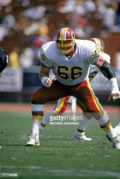 Joe Jacoby of the Washington Redskins gets ready on the line during a game against the Los Angeles Raider on August 22 1992 in Los Angeles California