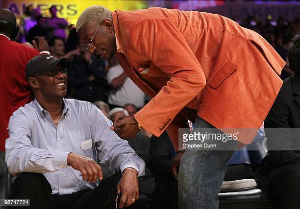 Joe 'Jelly Bean' Bryant the father of Kobe Bryant talks with DJ Mbenga of the Los Angeles Lakers looks on before Game Two of the Western Conference...