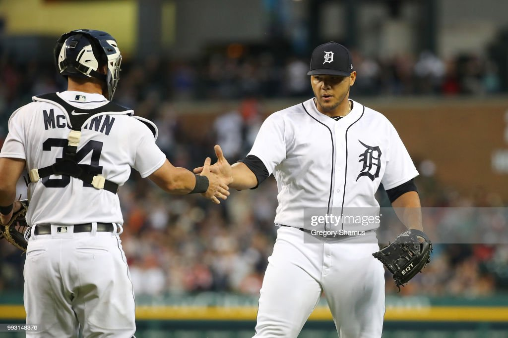 Joe Jimenez #77 of the Detroit Tigers celebrates a 3-1 win over the Texas Rangers with James McCann #34 at Comerica Park on July 6, 2018 in Detroit, Michigan.