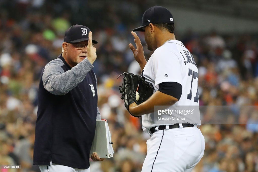 Joe Jimenez #77 of the Detroit Tigers celebrates a 3-1 win over the Texas Rangers with manger Ron Gardenhire at Comerica Park on July 6, 2018 in Detroit, Michigan.