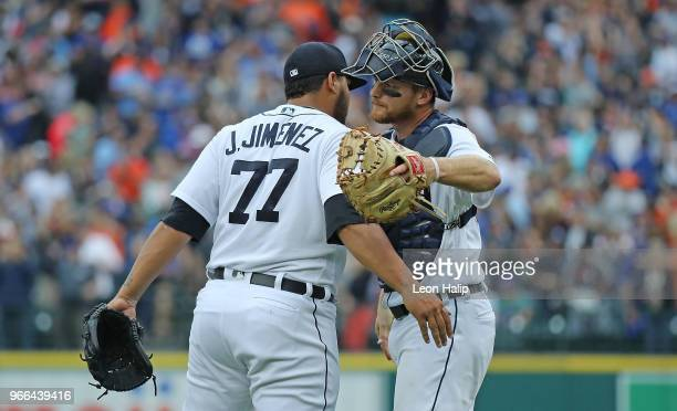 Joe Jimenez of the Detroit Tigers celebrates a win over the Toronto Blue Jays with teammate John Hicks at Comerica Park on June 2 2018 in Detroit...