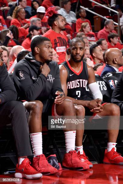 Joe Johnson and Chris Paul of the Houston Rockets look on in Game One of the Western Conference Semifinals against the Utah Jazz during the 2018 NBA...