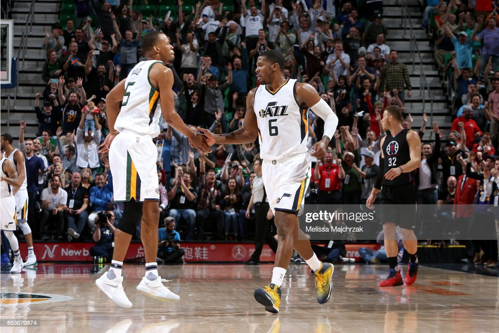 Joe Johnson #6 and Rodney Hood #5 of the Utah Jazz high five each other during the game against the Los Angeles Clippers on March 13, 2017 at EnergySolutions Arena in Salt Lake City, Utah.