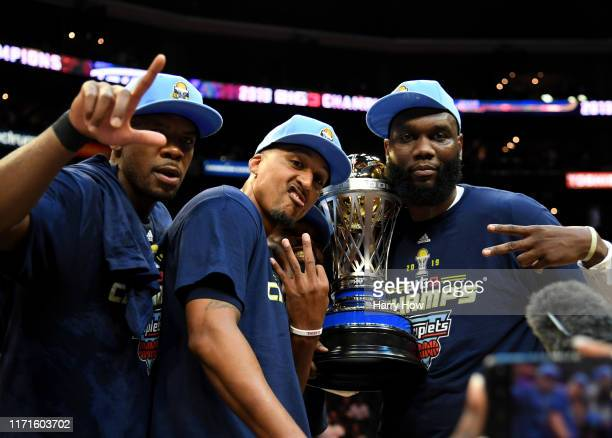 Joe Johnson, Jamario Moon and Al Jefferson of the Triplets pose with the trophy after winning the BIG3 Championship over the Killer 3s at Staples...