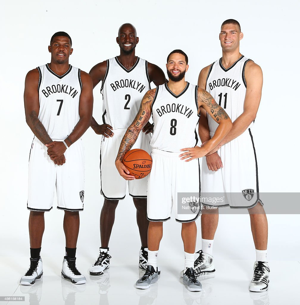 Joe Johnson #7, Kevin Garnett #2, Deron Williams #8 and Brook Lopez #11 of the Brooklyn Nets poses for a portrait during Media Day at the Nets practice facility on September 26, 2014 in East Rutherford, New Jersey.