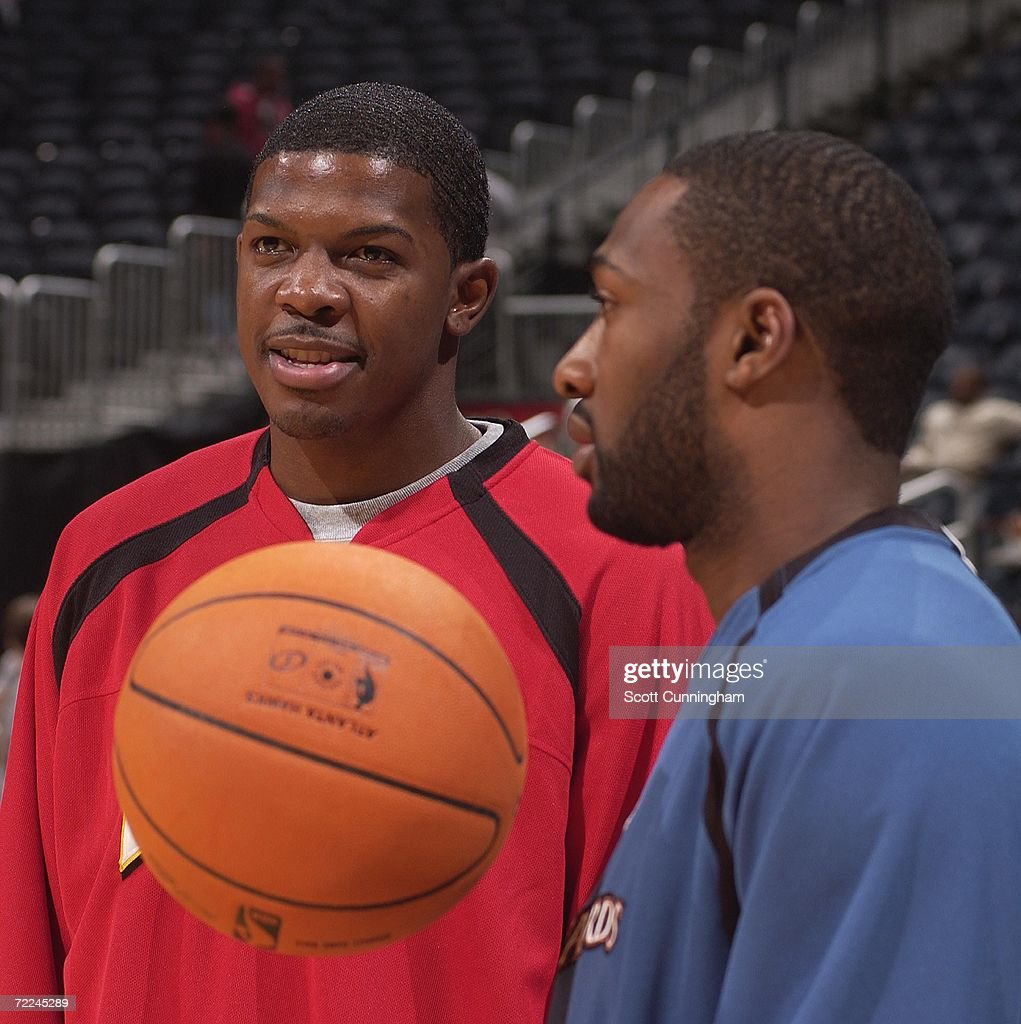 Joe Johnson #2 of the Atlanta Hawks chats with Gilbert Arenas #0 of the Washington Wizards before the game at Philips Arena on October 23, 2006 in Atlanta, Georgia.