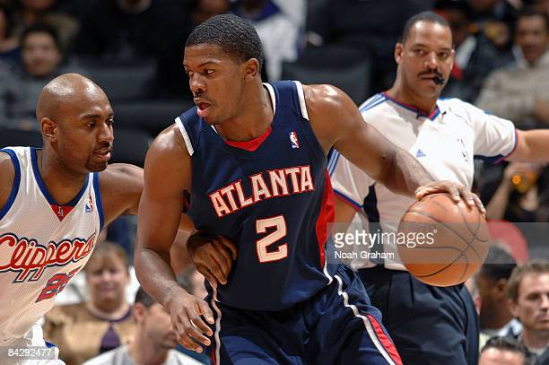 Joe Johnson of the Atlanta Hawks dribbles against Mardy Collins of the Los Angeles Clippers at Staples Center on January 14 2009 in Los Angeles...