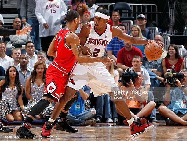 Joe Johnson of the Atlanta Hawks drives against Derrick Rose of the Chicago Bulls in Game Four of the Eastern Conference Semifinals in the 2011 NBA...