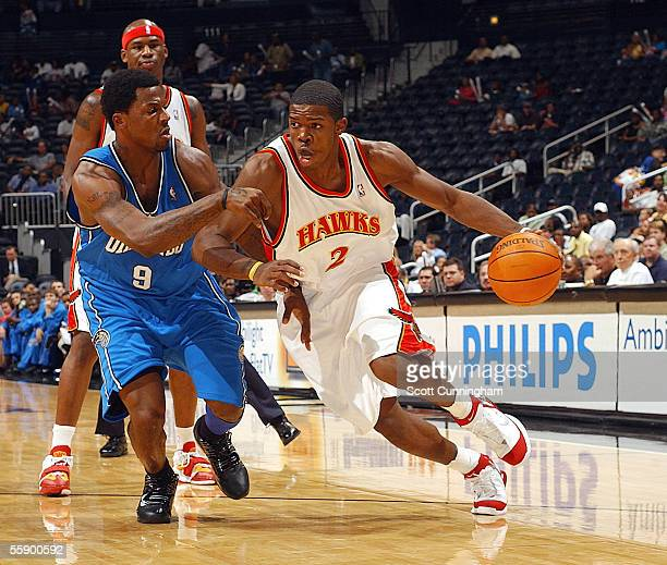 Joe Johnson of the Atlanta Hawks drives against DeShawn Stevenson of the Orlando Magic on October 11 2005 at Philips Arena in Atlanta Georgia NOTE TO...