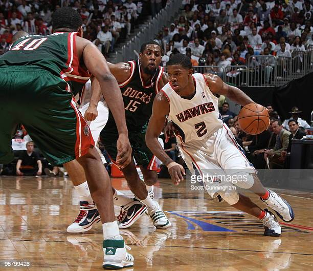 Joe Johnson of the Atlanta Hawks drives against John Salmons of the Milwaukee Bucks in Game Seven of the Eastern Conference Quarterfinals during the...