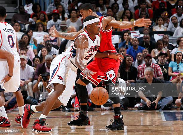 Joe Johnson of the Atlanta Hawks drives around Derrick Rose of the Chicago Bulls in Game Four of the Eastern Conference Semifinals in the 2011 NBA...