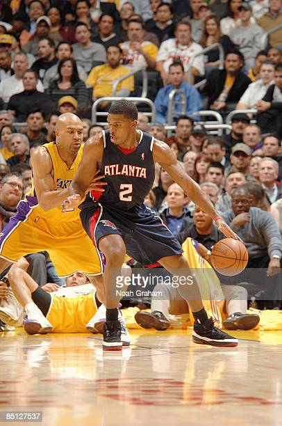 Joe Johnson of the Atlanta Hawks drives the ball against Derek Fisher of the Los Angeles Lakers during the game on February 17, 2009 at Staples...