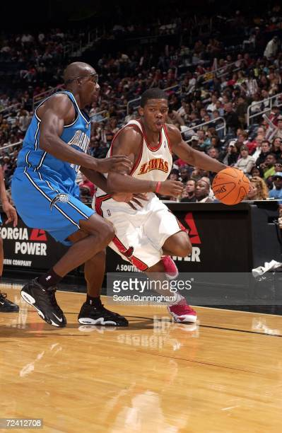 Joe Johnson of the Atlanta Hawks drives to the basket against Keith Bogans of the Orlando Magic on November 5 2006 at Philips Arena in Atlanta...