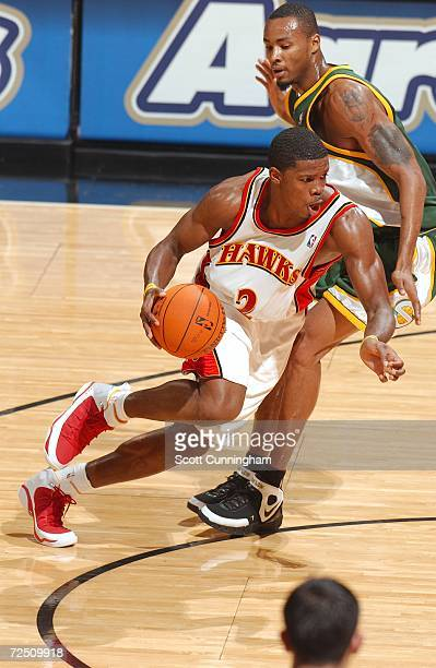Joe Johnson of the Atlanta Hawks drives to the basket against Rashard Lewis of the Seattle SuperSonics on November 11 2006 at Philips Arena in...