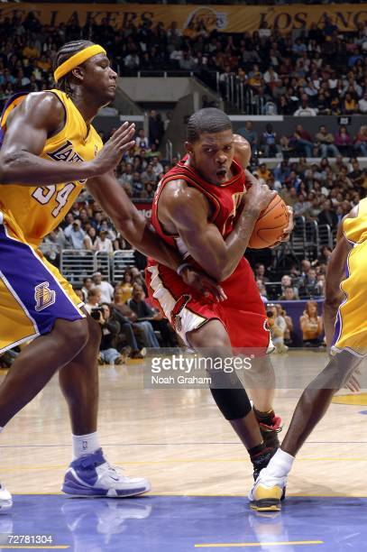 Joe Johnson of the Atlanta Hawks drives to the hoop against Kwame Brown of the Los Angeles Lakers on December 8 2006 at Staples Center in Los Angeles...