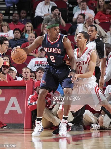 Joe Johnson of the Atlanta Hawks handles the ball against Kevin Martin of the Houston Rockets on April 3 2011 at the Toyota Center in Houston Texas...