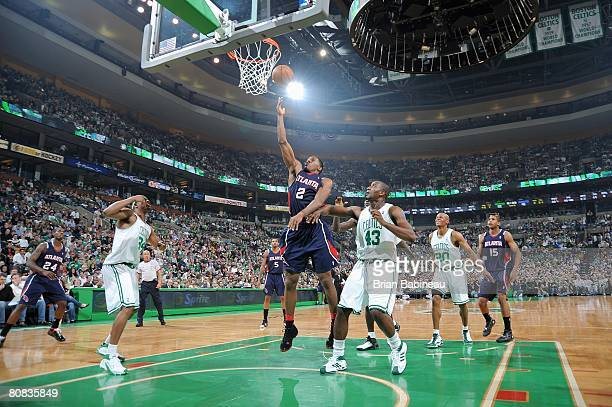 Joe Johnson of the Atlanta Hawks lays a shot up over Kendrick Perkins of the Boston Celtics in Game One of the Eastern Conference Quarterfinals...