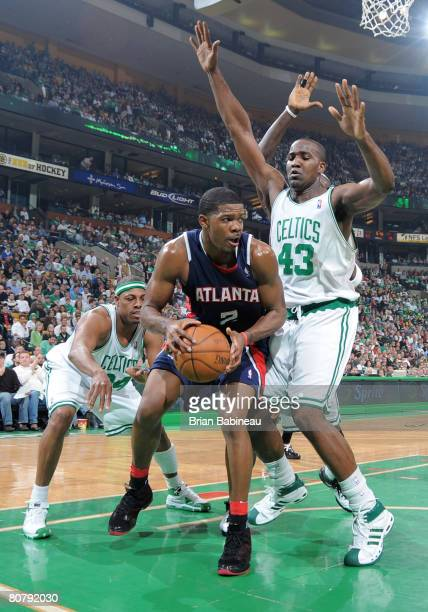 Joe Johnson of the Atlanta Hawks looks for a play against Kendrick Perkins of the Boston Celtics in Game One of the Eastern Conference Quarterfinals...
