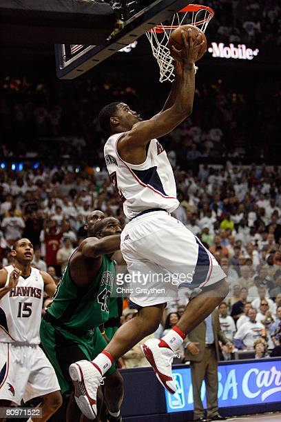 Joe Johnson of the Atlanta Hawks makes a shot around Kendrick Perkins of the Boston Celtics in Game Six of the Eastern Conference Quarterfinals...