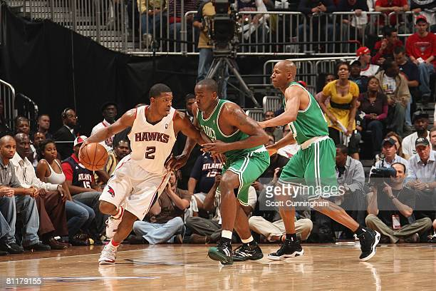 Joe Johnson of the Atlanta Hawks moves the ball against Kendrick Perkins and Ray Allen of the Boston Celtics in Game Four of the Eastern Conference...