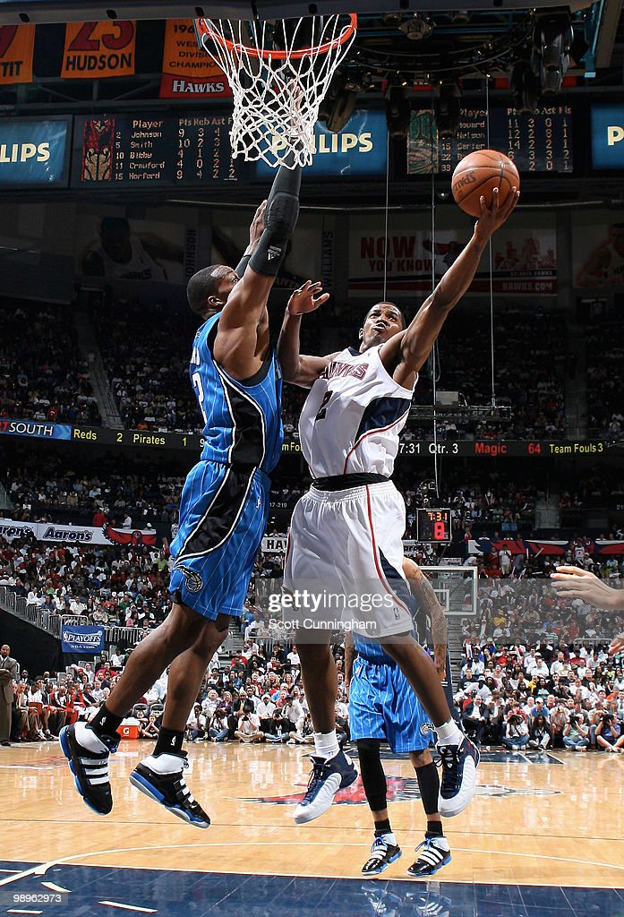 Joe Johnson of the Atlanta Hawks puts up a shot against Dwight Howard of the Orlando Magic in Game Four of the Eastern Conference Semifinals during the 2010 NBA Playoffs on May 10, 2010 at Philips Arena in Atlanta, Georgia.