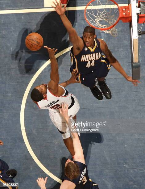 Joe Johnson of the Atlanta Hawks puts up a shot against Solomon Jones of the Indiana Pacers on March 28 2010 at Philips Arena in Atlanta Georgia NOTE...