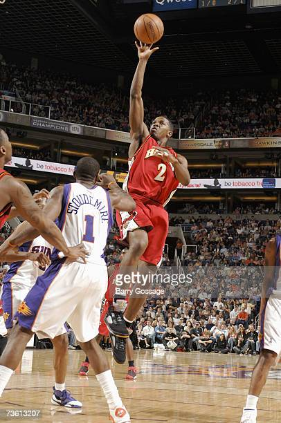Joe Johnson of the Atlanta Hawks puts up a shot over Amare Stoudemire of the Phoenix Suns on February 9 2007 at US Airways Center in Phoenix Arizona...